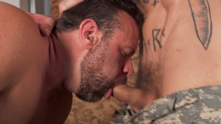 tattooed hunk wants to feel his cock in this guy's mouth