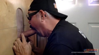 executive gets his big dick sucked at glory hole