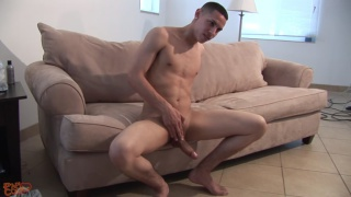 papi strokes his huge dick on the couch