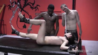 slave boy's legs raised in anticipation of what's coming