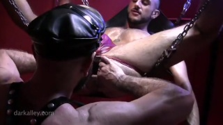 leather man fucks his boy in the sling