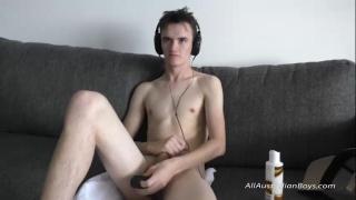 aussie boy slips a butt plug inside his ass