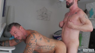 bearded hunk plays with his nipples while fucking