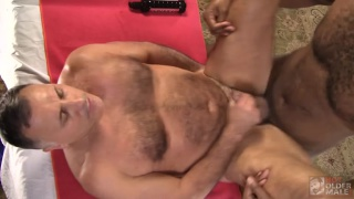 beefy daddy gets his ass fucked on massage table