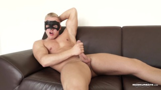 masked blond muscle hunk jerks his uncut cock