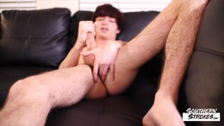 dark-haired cutie strokes his curved cock