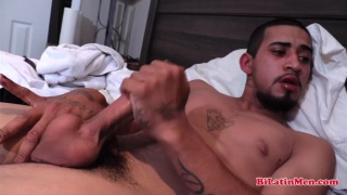 handsome bearded latino strokes out a load