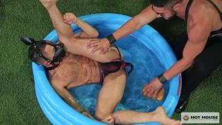 master gives his puppy boy a bath