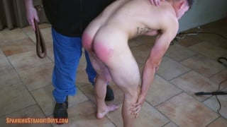handsome guy bent over and strapped