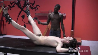 slave boy restrained and flogged upside down
