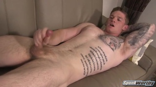 heavily-inked stud strokes his meaty cock