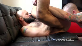sneaker guy sucks a bearded man's cock