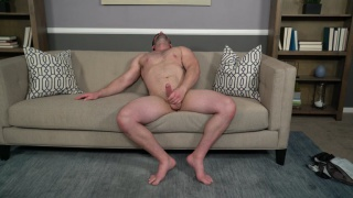 buff hunk with shaved body jerks his meaty cock