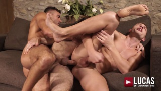 three men daisy-chain fucking on the couch