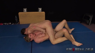 wrestlers jack off in a race to cum