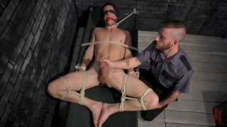 blindfolded, gagged and bound guy gets his dick edged