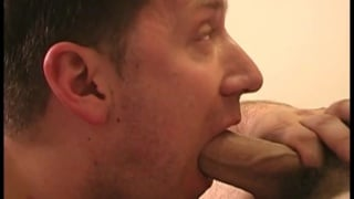 guy with a big mouthful of cock