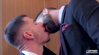bearded man in suit forces guy to suck his cock