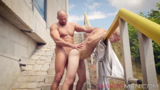 muscle hunk fucks blond lad outdoors on stairs