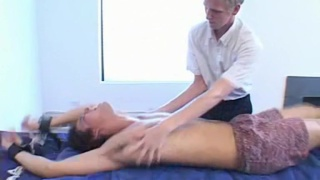 guy strapped to the massage table and tickled