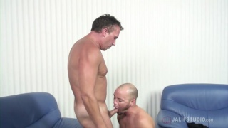bald guy fucks a daddy with his legs in the air