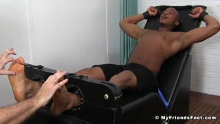 sexy black stud gets his bare feet tickled relentlessly
