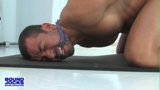 dominik rider tied up in his jockstrap on gym floor