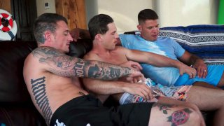 couch threeway breaks out while guys are watching football
