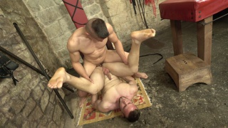 uncut guy gets fucked in a sex dungeon