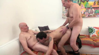 two hot daddies share a bottom's mouth and ass