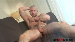 Sexy hairy muscled skinhead jerks his dick