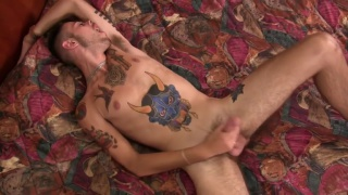guy with devil tattoo on his belly jerks off