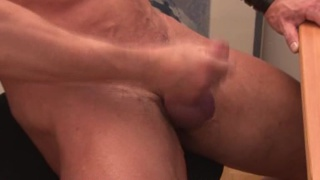 Muscle stud jerks off at his computer
