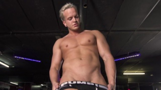 blond beefcake works his stripper pole