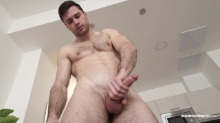 furry chiseled hunk does a back-handed jack-off