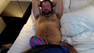 hairy bear gets serviced by masked hunk