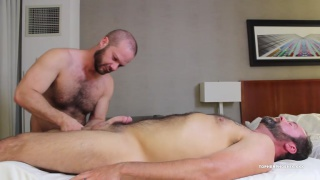 bald masseur strokes daddy's dick during massage