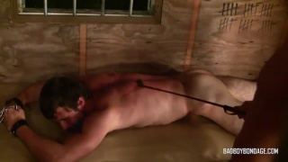 slave boy with very hairy legs gets beaten with riding crop