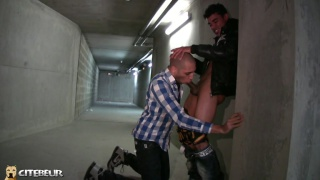 bald guy sucking dick in a parking garage