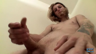 sruffy-face blond strokes his hard cock