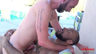 bearded bottom rides a 9-inch black dick