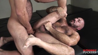 two hairy daddies fuck in a bathhouse