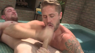 two hunks sucking dick in outdoor hot tub