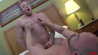 playing with bottom's nippled while he rides dick