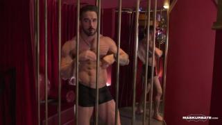male stripper in a cage