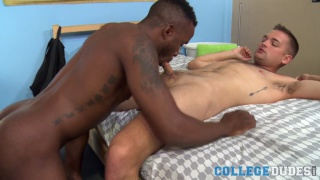 black stud hungrily sucks his bottom's cock before fucking him