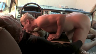 blond hunk sucking driver's dick in car