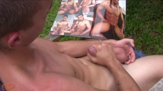 guy spanks his papi cock while looking at porn mag