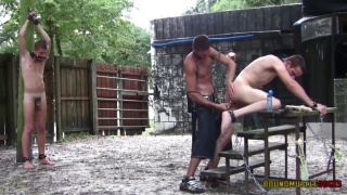 master dildo fucks one slave while another watches
