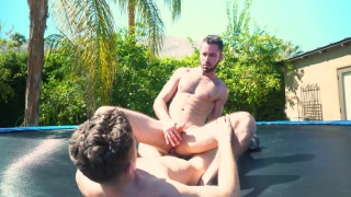 horny studs fuck on an outdoor trampoline